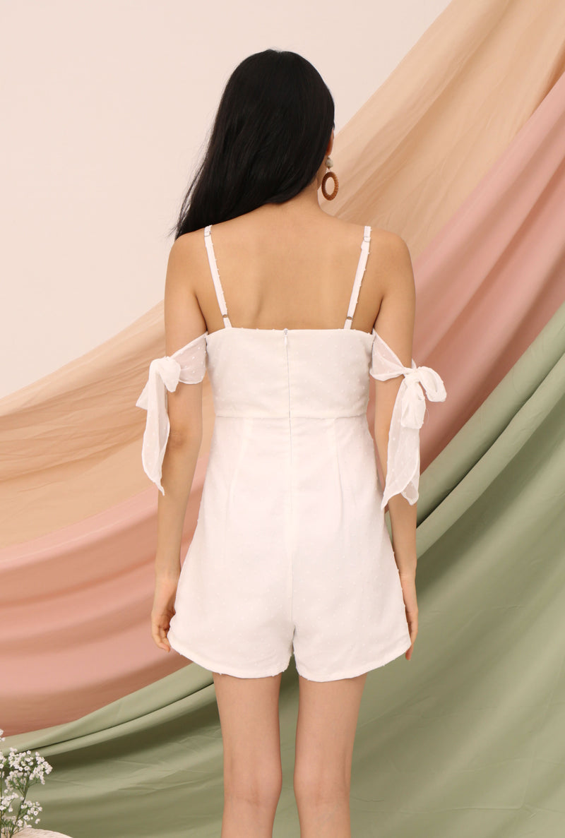 Claire Cold Shoulder Tie-Ribbon Romper (White Dobby Dot) l Dear Lyla Singapore l Shop Online Women Fashion Lunch dates, weekend gatherings, parties - this lovely romper brings you to places. The romper features an adorable an adjustable tie detail to create an off-shoulder look to elevate your look.   - Adjustable straps - Concealed back zip closure - Lined - Made of polyester - Functional Side Pockets  *Due to cut of fabric, placement of prints will differ for every piece.