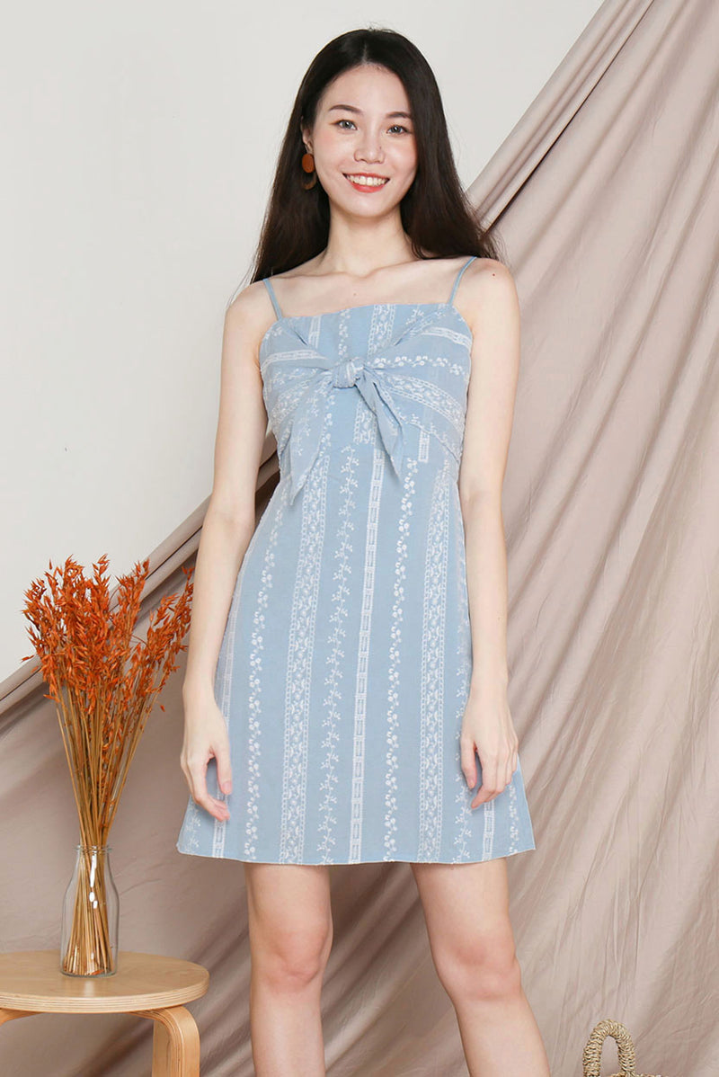 Darlia Tie-Knot Embroidery Dress #MadeByDearLyla (Powder Blue) l Dear Lyla Singapore l Shop Women Fashion Online This dainty embroidery number is just the dress you need for your lovely weekend outings. Features a self-tie knot detail at the bust for an added touch of femininity which brings out your sweet and girly side.  -Concealed back zip closure -Lined  -Adjustable straps  -Made of embroidery cotton   Available in White and Powder Blue.