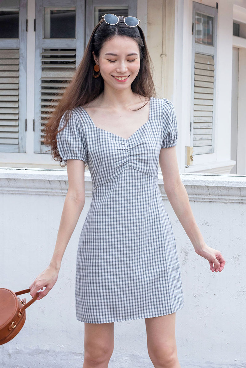 Desiree Gingham Ruched Dress #MadeByDearLyla (Black) l Dear Lyla Singapore l Shop Women Fashion This vintage-inspired gingham dress features ruched details and sweetheart neckline that flatters your figure by accentuating your waist, bust and collarbones. It has slight puffy sleeves for that added feminine detail. Cut from lightweight and breathable cotton blend with the trendiest gingham prints. This dress will bring you to places - it is appropriate for work and great for weekend outings too!