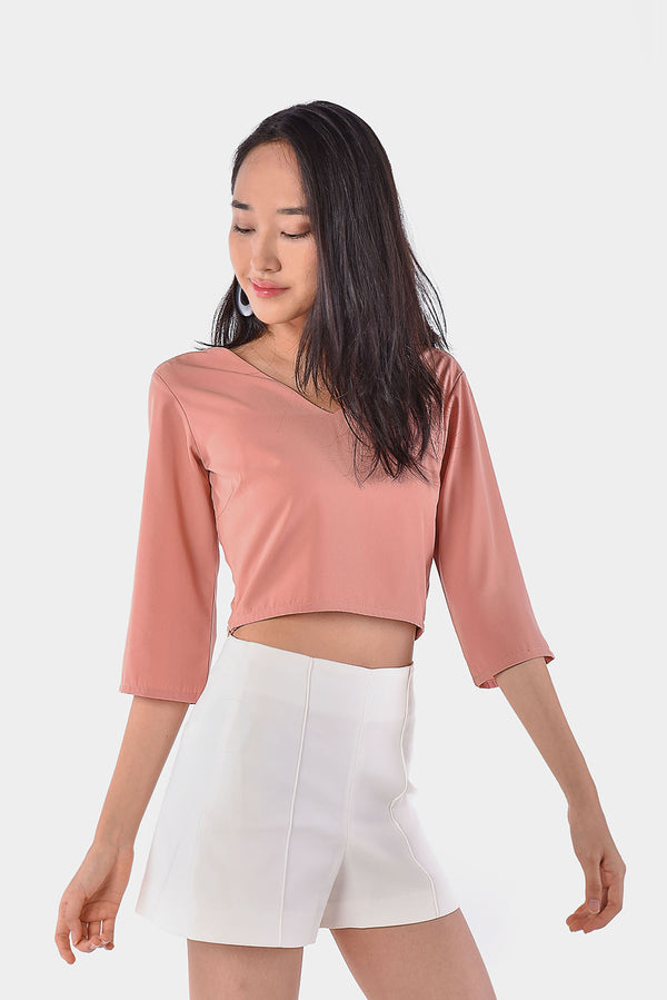 Fion V-back Crop Top (Blush) l Dear Lyla Singapore l Shop Online Women Fashion Featuring a V-back design which is classy yet elegant. This crop top is best paired with high-waisted bottoms.  - Concealed side zip closure - Lined - Made of polyester  Available in Blush and White.  Exclusively manufactured by Dear Lyla.