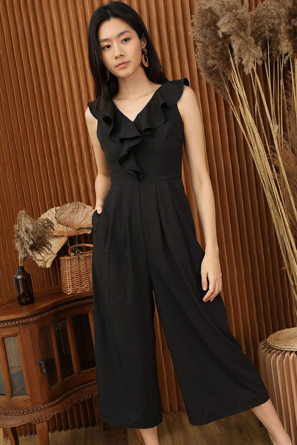 Fiona Ruffle Shoulder Jumpsuit #MadeByDearLyla (Black) l Dear Lyla Singapore l Shop Women Fashion A timeless number - Fiona features a ruffle V-neckline that drapes elegantly from your shoulder to bust which accentuates your collar bones and curves effortlessly. This wide leg bottom is designed to give you legs for days. Look chic and feel comfortable in this lightweight jumpsuit from day to night.