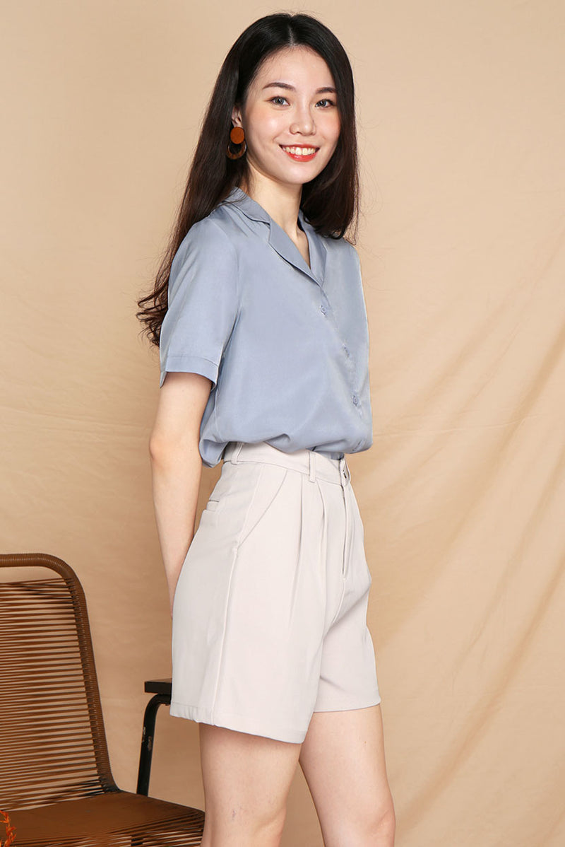 Freda Oversized Button Down Shirt (Dusty Blue) l Dear Lyla Singapore l Shop Women Fashion A versatile wardrobe essential - this shirt features a relaxed fit with functional front buttons. Pair it with a pair of jeans or midi skirt to dress down for work, or simply pair it with shorts for your casual weekend outings!   -Made of polyester -Not lined, non-sheer -Functional front buttons  Available in Dusty Blue and Sand.  Pair it with our Brooklyn Tailored Shorts (Sand) to complete the look.