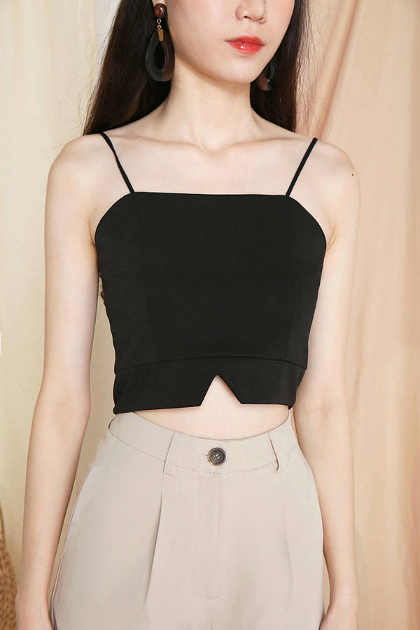 Gail Camisole Crop Top (Black) l Dear Lyla Singapore l Shop Women Fashion This camisole crop top is a simple yet classy piece that pairs well for all outfits. Dress it up with high waist pants or skirt for a dressy look or go casual by pairing it with jeans. This versatile piece is a wardrobe staple.  - Back zip closure - Lined - Made of polyester   Available in Black and White.  Pair it with our Blair Tailored Shorts (Sand) or Mistletoe Flowy Slit Pants (Rust) to complete the look.