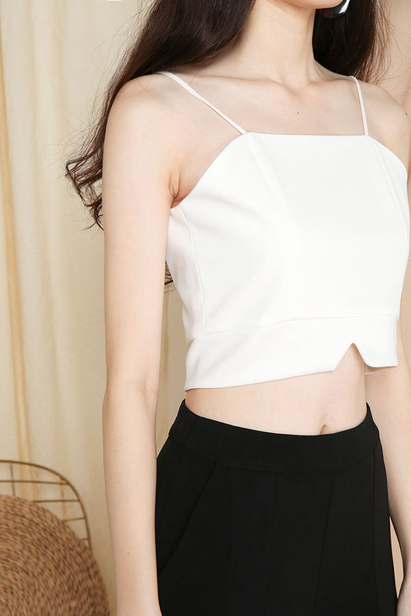Gail Camisole Crop Top (White) l Dear Lyla Singapore l Shop Women Fashion This camisole crop top is a simple yet classy piece that pairs well for all outfits. Dress it up with high waist pants or skirt for a dressy look or go casual by pairing it with jeans. This versatile piece is a wardrobe staple.  - Back zip closure - Lined - Made of polyester   Available in Black and White.  Pair it with our Blair Tailored Shorts (Sand) or Mistletoe Flowy Slit Pants (Rust) to complete the look.
