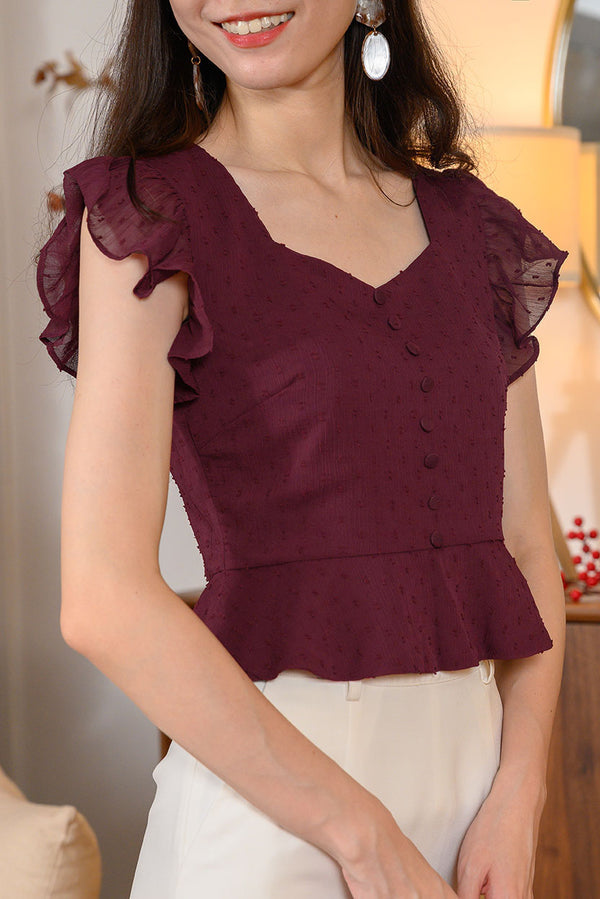 Hayley Peplum Top #MadeByDearLyla (Maroon Swiss Dot) l Dear Lyla Singapore l Shop Women Fashion Features ruffled sleeves and a frilled hem that accentuates your waistline, this flattering and feminine peplum top is your go-to for your Chinese New Year gatherings. Go for Maroon Swiss Dot for a classy Chinese New Year look or Cream Floral for a feminine and sweet look!  - Concealed side zip closure - Lined - Made of polyester - Non-functional fabric button  Available in Maroon Swiss Dot and Cream Floral.