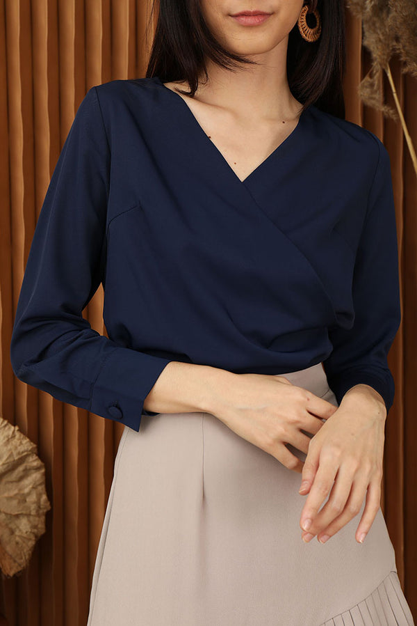 Helen Overlap Sleeved Top #MadeByDearLyla (Navy) | Dear Lyla Singapore | Shop Women Fashion | Free Shipping to Singapore & Malaysia | Designed by DEAR LYLA, made specially for you. | Exclusively manufactured by Dear Lyla | Online Women Clothing Singapore Store Blogshop Top 10 Quality | Timeless Classic - we all need a long-sleeve top in our wardrobe for that improtant meeting or day at work. A versatile, must-have piece that will never go wrong. Featuring an overlap detail at the front to elevate the look.