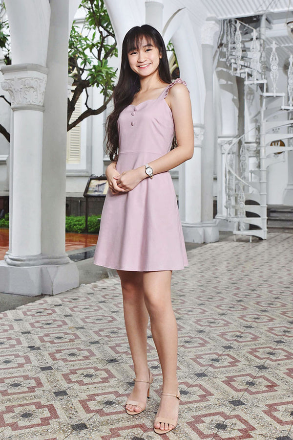 Juliet Sweetheart Button Dress (Dusty Pink) | Dear Lyla Singapore | Shop Online Women Fashion Cut from a lightweight cotton fabric which is very comfy for daily wear. Featuring a sweetheart neckline which accentuates your collarbone and finished with exquisite wooden buttons. This dress is femine and dainty. For those looking for a cute but subtle couple outfit, this ones for you. Get your partner to wear our Romeo Men Shirt for an adorable couple look!