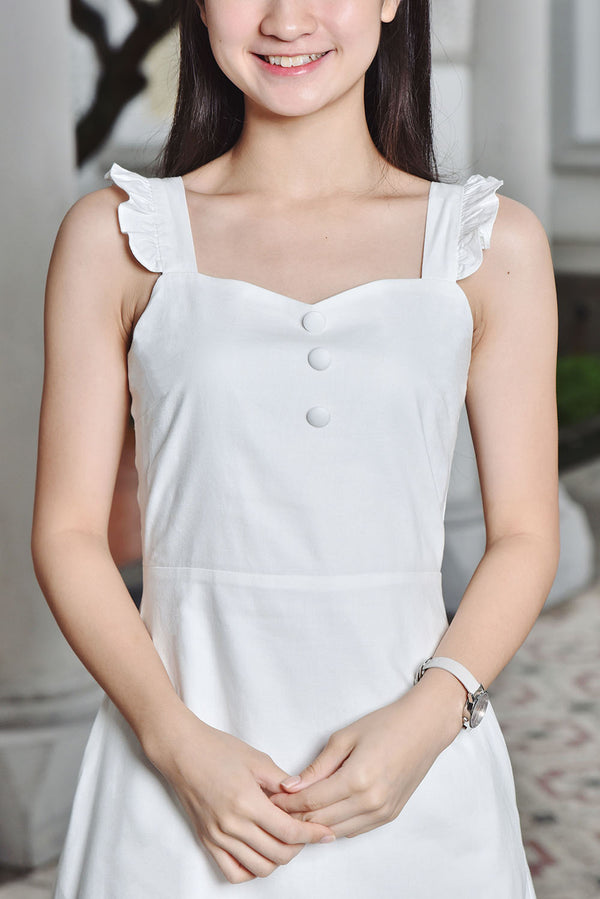 Juliet Sweetheart Button Dress (White) | Dear Lyla Singapore | Shop Online Women Fashion Cut from a lightweight cotton fabric which is very comfy for daily wear. Featuring a sweetheart neckline which accentuates your collarbone and finished with exquisite wooden buttons. This dress is femine and dainty. For those looking for a cute but subtle couple outfit, this ones for you. Get your partner to wear our Romeo Men Shirt for an adorable couple look!