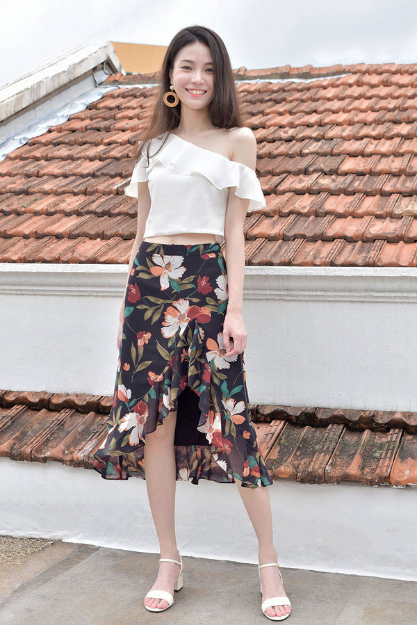 Kayla Flutter Midi Skirt #MadeByDearLyla (Black Floral) l Dear Lyla Singapore l Shop Online Women Fashion This dressy yet not overly formal midi skirt is great for all occasions and matches easily with any top in your wardrobe. Features a slit with ruffle details that adds a touch of femininity and shows off just the right right amount of legs to elongate your silhouette.  - Concealed back zip closure - Lined - Made of polyester  Available in Black Floral and White.  Pair it with our Laura Ruffle Toga Top