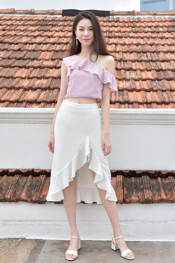 Kayla Flutter Midi Skirt #MadeByDearLyla (White) l Dear Lyla Singapore l Shop Online Women Fashion This dressy yet not overly formal midi skirt is great for all occasions and matches easily with any top in your wardrobe. Features a slit with ruffle details that adds a touch of femininity and shows off just the right right amount of legs to elongate your silhouette.  - Concealed back zip closure - Lined - Made of polyester  Available in Black Floral and White.  Pair it with our Laura Ruffle Toga Top