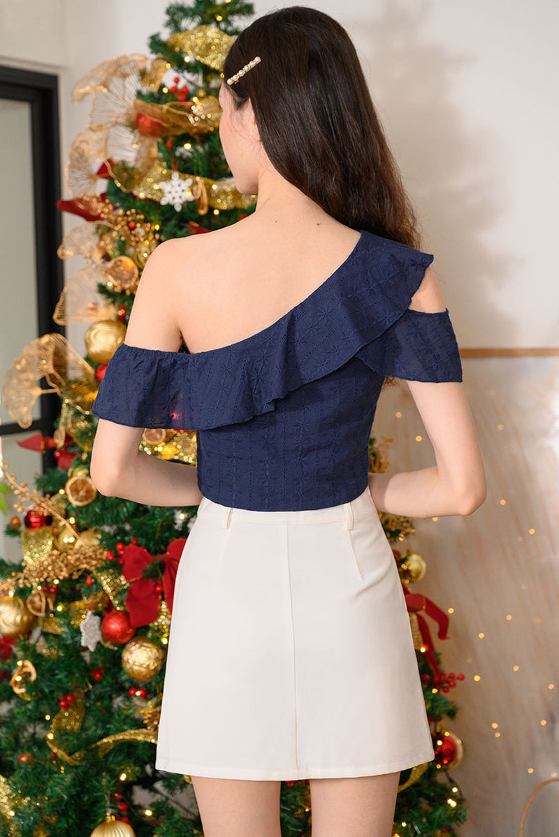 Laura Ruffle Toga Top #MadeByDearLyla (Navy Eyelet) Laura is back by popular demand and this time in lovely intricate eyelet fabric! This toga top is just the top you need for a dreamy and feminine look. Show off your collar bones in this lovely piece that goes well with any bottoms. It's the perfect top for this festive season - pair with a skirt for a classy look, or style it will pants for a chic look. Exclusively manufactured by Dear Lyla.