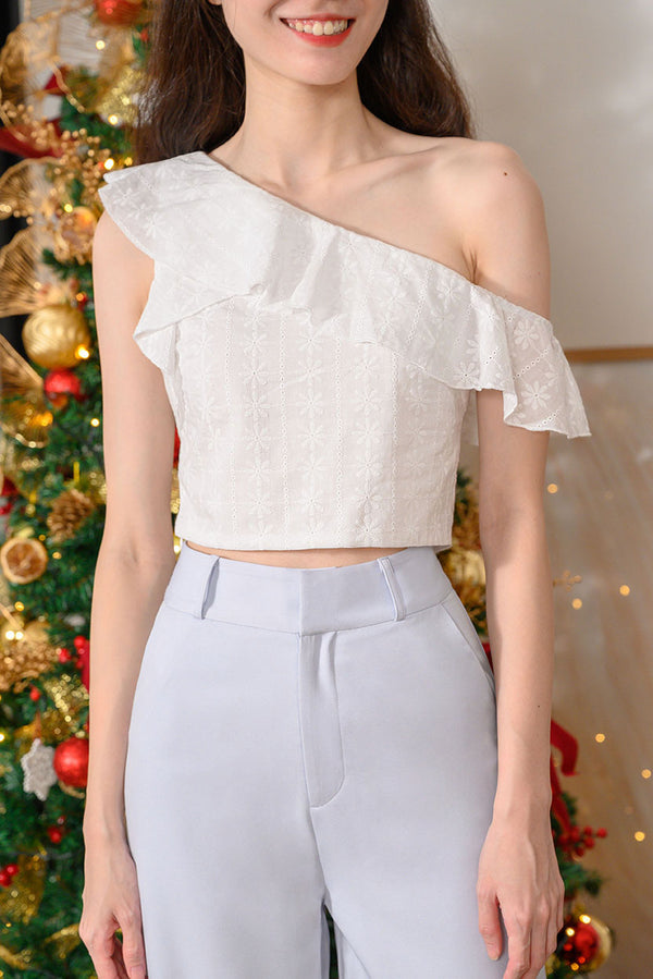 Laura Ruffle Toga Top #MadeByDearLyla (White Eyelet) Laura is back by popular demand and this time in lovely intricate eyelet fabric! This toga top is just the top you need for a dreamy and feminine look. Show off your collar bones in this lovely piece that goes well with any bottoms. It's the perfect top for this festive season - pair with a skirt for a classy look, or style it will pants for a chic look. Exclusively manufactured by Dear Lyla.
