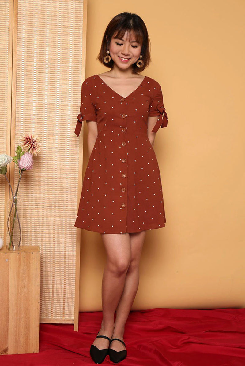 Lily Polka Dot Button Down Dress #MadeByDearLyla (Burnt Orange)| Dear Lyla Singapore | Shop Women Fashion | Free Shipping to Singapore & Malaysia | Designed by DEAR LYLA, made specially for you. | Exclusively manufactured by Dear Lyla | Online Women Clothing Singapore Store Blogshop Top 10 Quality | In mini polka dot prints, this button down dress features self-tie ribbon details at the sleeve, making this adorable dress a unique piece for your lunch date and gatherings.