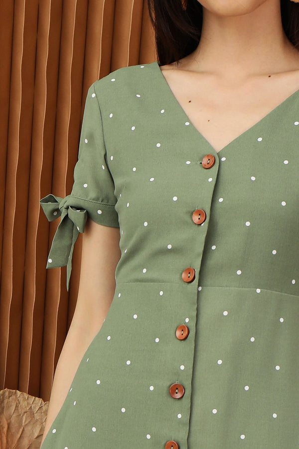 Lily Polka Dot Button Down Dress (Green) | Dear Lyla Singapore | Shop Women Fashion | Free Shipping to Singapore & Malaysia | Designed by DEAR LYLA, made specially for you. | Exclusively manufactured by Dear Lyla | Online Women Clothing Singapore Store Blogshop Top 10 Quality | In mini polka dot prints, this button down dress features self-tie ribbon details at the sleeve, making this adorable dress a unique piece for your lunch date and gatherings.