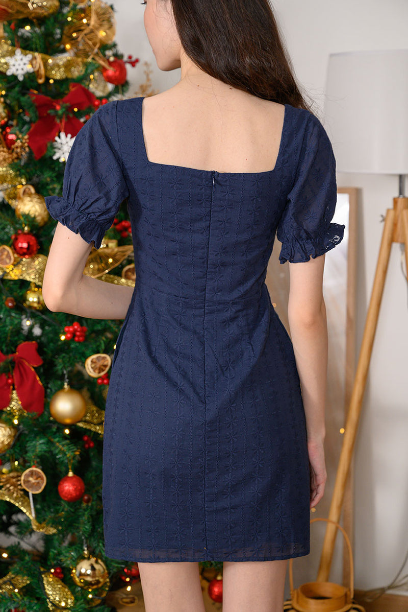Lisa Puff Sleeve Eyelet Dress #MadeByDearLyla (Navy Eyelet) The puffy frill sleeves and elegant fold details at the overlap neckline adds a touch of femininity and vintage vibes to this classy piece. It's cut from embroidery cotton with intricate stunning eyelet details, which brings you from work to play comfortably. You won't go wrong with this dress this festive season.  - Concealed back zip closure - Functional side pockets - Lined - Made of embroidery cotton  Available in Navy Eyelet and White Eyelet.