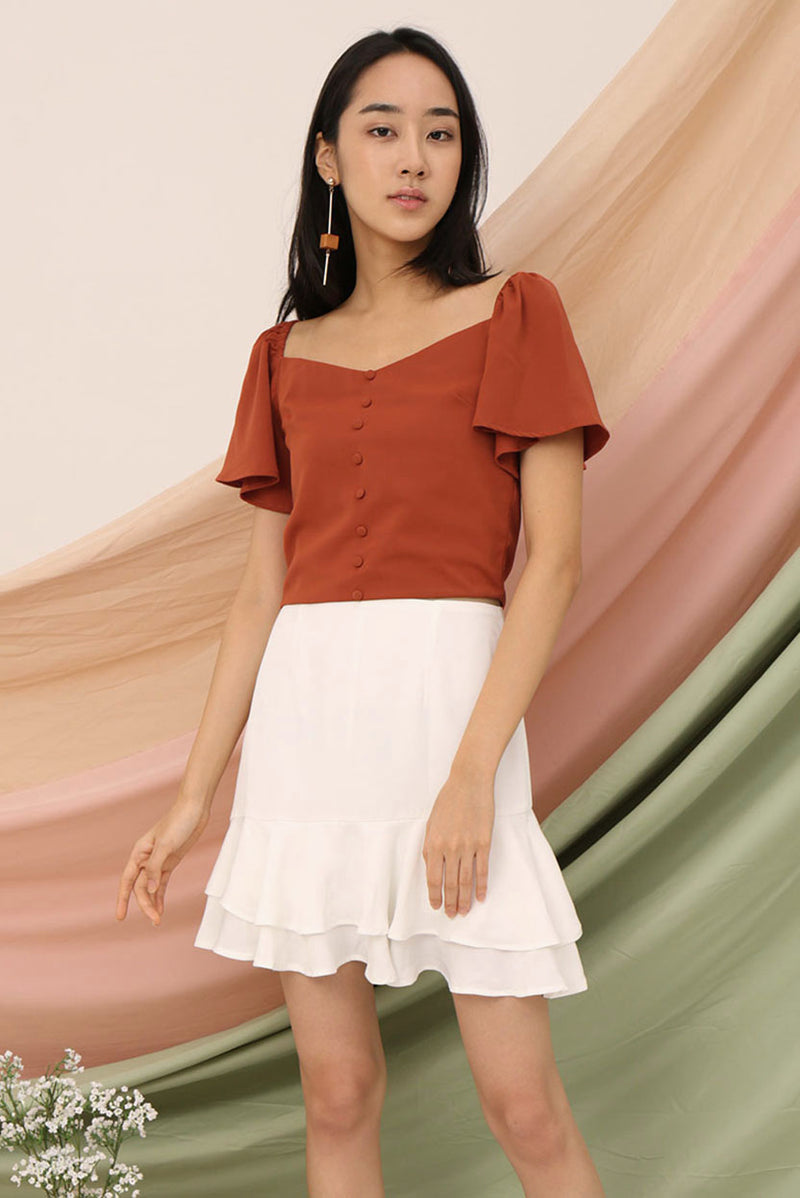 Lizzie Offsie Sleeve Two-Way Top (Rust) l Dear Lyla Singapore l Shop Women Fashion Online Can't decide between an off-shoulder or a sleeve top? Get the best of both worlds with this top! This is a top can be worn to any occasion from brunches to evening gatherings. We absolutely love how versatile this two-way top is!   - Concealed side zip closure - Lined - Made of polyester  Available in Rust and White Dobby Dot.  Exclusively manufactured by Dear Lyla.  Pair it with our Kelsey Flutter Skorts