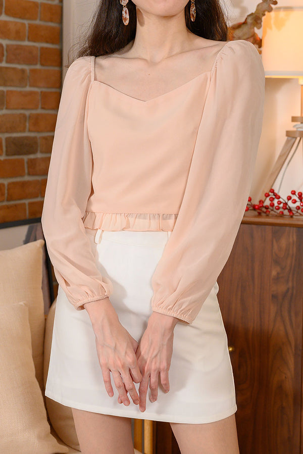 Luna Two Way Puff Sleeve Top #MadeByDearLyla (Pale Peach) l Dear Lyla Singapore l Shop Women Fashion We can't get enough of puff sleeves! Look elegant in this fairy-like puff sleeve blouse with sweetheart neckline and small frills at hem which is easily the most dreamy top in your wardrobe.   - Concealed side zip closure - Lined - Made of embroidery cotton for bodice, chiffon for sleeves