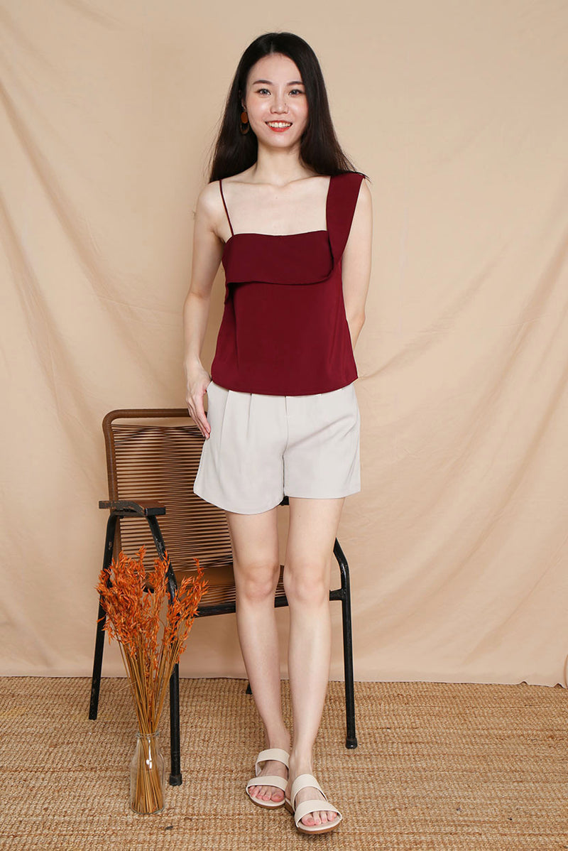 Merry Fold Top #MadeByDearLyla (Maroon) Elevate your look with our Merry Fold Top which makes you look effortlessly chic even if you dress down in a pair of jeans. This unique piece would definitely make you stand out. A refreshing addition to your wardrobe.  - Concealed side zip closure - Lined - Made of polyester  Available in Maroon and White.  Exclusively manufactured by Dear Lyla.  Pair with our Mistletoe Flowy Slit Pants or our upcoming Tracey Tailored Shorts (Sand) to complete the look