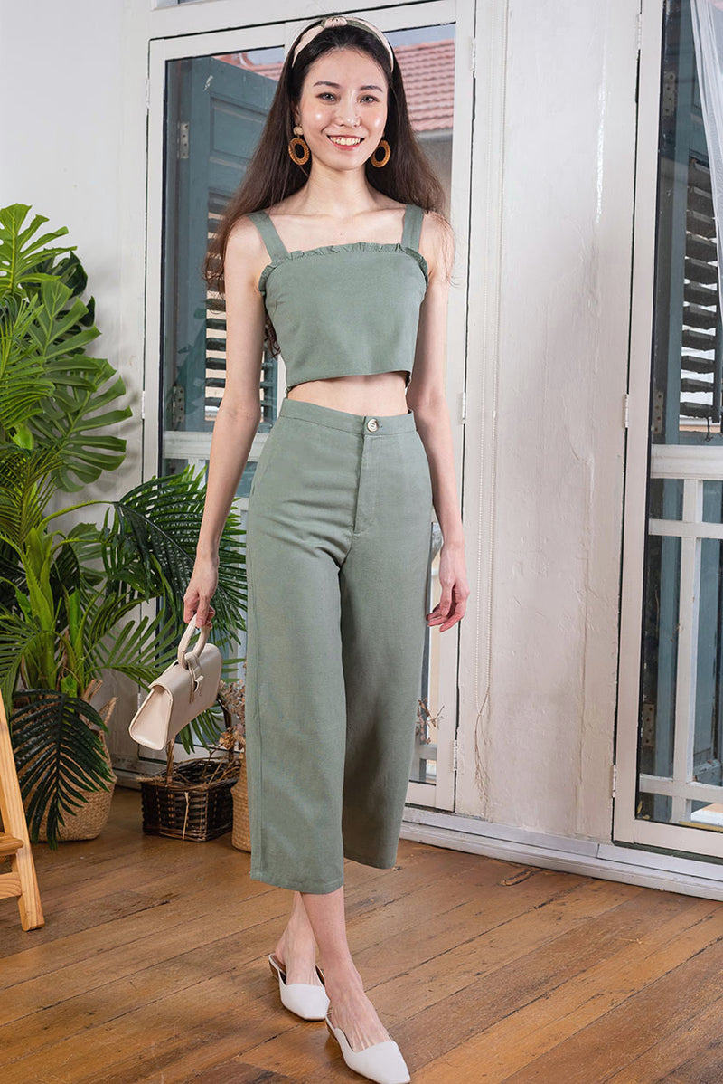 Olivia Linen Top #MadeByDearLyla (Olive) l Dear Lyla Singapore l Shop Women Fashion This lightweight linen top features cute frills at the bust for a touch of femininity. It's cut from breathable and comfortable linen fabric fabric which will keep you cool and comfy in Singapore's weather. Featuring a square neckline to show off your collarbones and the cropped length for a youthful look.  - Concealed side zip closure  - Lined  - Made of linen   Available in Sand and Olive.
