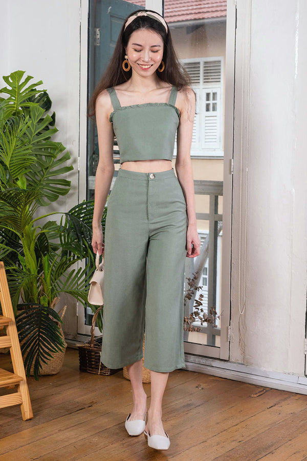 Olivia Linen Culottes #MadeByDearLyla (Olive)  l Dear Lyla Singapore l Shop Women Fashion  This lightweight linen culottes features functional tortoise shell button at the front for a chic look. It's cut from breathable and comfortable linen fabric which feels so comfy and soft that you will find yourself reaching out for it again and again. This versatile number will pair well with all tops in your wardrobe.   - Functional tortoise shell front button and front zip closure - Functional side pockets
