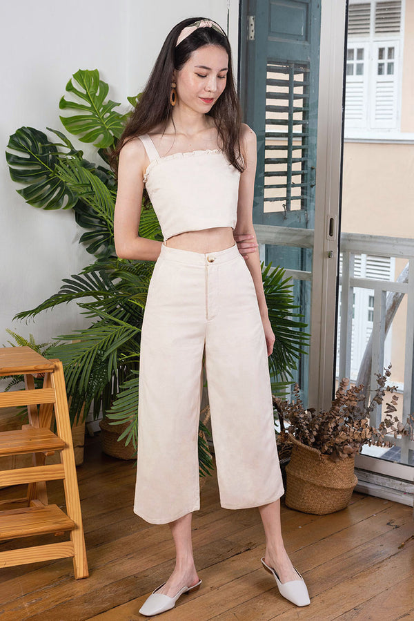 Olivia Linen Culottes #MadeByDearLyla (Sand)  l Dear Lyla Singapore l Shop Women Fashion  This lightweight linen culottes features functional tortoise shell button at the front for a chic look. It's cut from breathable and comfortable linen fabric which feels so comfy and soft that you will find yourself reaching out for it again and again. This versatile number will pair well with all tops in your wardrobe.   - Functional tortoise shell front button and front zip closure - Functional side pockets