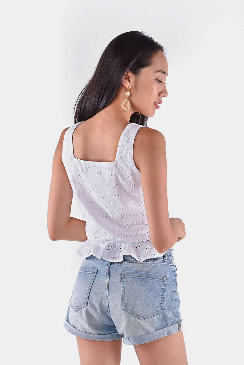 Phoebe Eyelet Crop Top (White) l Dear Lyla Singapore l Shop Women Fashion  This cotton eyelet top with ruffled hem details is perfect for a fun and flirty look. Pair this crop top with high-waisted bottoms.  - Concealed side zip closure - Lined - Made of cotton blend  Available in Pink and White.  Exclusively manufactured by Dear Lyla.