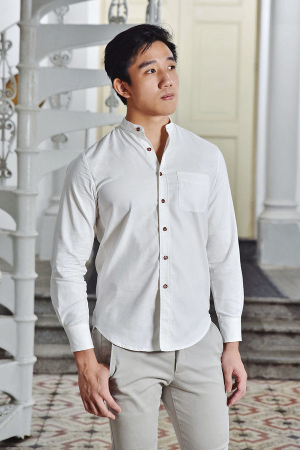 Romeo Mandarin Collar Slim Fit Men Shirt (White) | Dear Lyla Singapore | Shop Women Fashion Cut from a lightweight cotton fabric which is very comfy for daily wear. This stylish slim fit shirt is fitted with a chest pocket and button sleeve cuffs which allows you to wear your sleeves down for formal occassions or rolled up for a smart casual look. Finished withmandarin collarand exquisite wooden buttons for an added touch of details. *Get Matchy with your partner, Juliet Sweetheart Button Cotton Dress