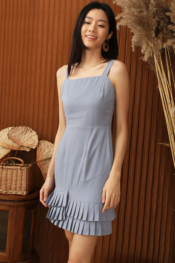 Sophia Pleated Dress (Dusty Blue) | Dear Lyla Singapore | Shop Women Fashion Online This pleated dress is a must-have to add to your wardrobe which brings you from day to night. We love the pleated overlap hem detail which adds a special touch to this chic piece. Designed with a square neck to show-off your collarbone.  - Concealed back zip closure - Lined - Made of polyester - Functional Side pockets  Available in Dusty Blue and Navy Confetti .  Exclusively manufactured by Dear Lyla.