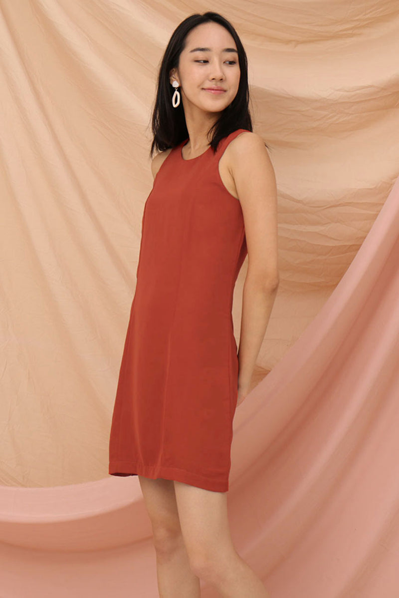 Tabitha Shift Dress (Tangerine) l Dear Lyla Singapore l Shop Women Fashion Basic must-have shift dress that is oh-so-comfy to wear. Casual fridays done right, or dress it up with a blazer for a formal look.  - Concealed back zip closure - Lined - Made of polyester  Available in Tangerine and Olive.  Exclusively manufactured by Dear Lyla.