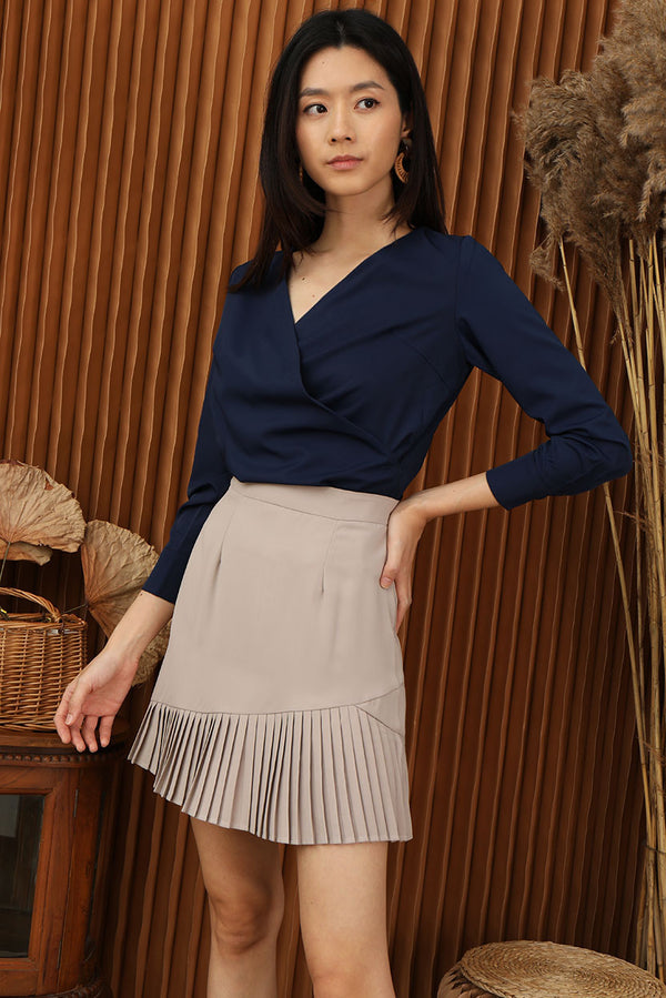 Tavia Pleated Skirt #MadeByDearLyla (Taupe) | Dear Lyla Singapore | Shop Women Fashion | Free Shipping to Singapore & Malaysia | Designed by DEAR LYLA, made specially for you. | Exclusively manufactured by Dear Lyla | Online Women Clothing Singapore Store Blogshop Top 10 Quality | Featuring a layered pleated hem, this versatile skirt pairs beautifully with any tops for a polished yet feminine look.