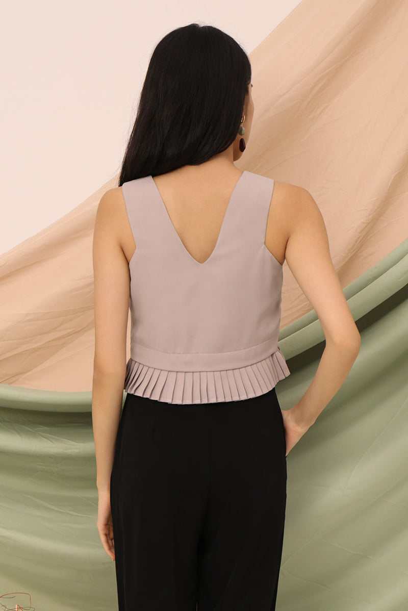 Tricia Pleated Crop Top #MadeByDearLyla (Taupe) | Dear Lyla Singapore | Shop Women Fashion | Free Shipping to Singapore & Malaysia | Designed by DEAR LYLA, made specially for you. | Exclusively manufactured by Dear Lyla | Online Women Clothing Singapore Store Blogshop Top 10 Quality | Spice up your outfit wit this cut-in top with pleated hem. We abosolutely love how effortlessly chic this top looks. Great for work and weekends.