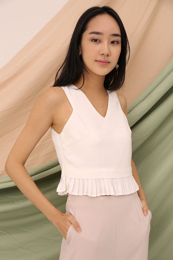 Tricia Pleated Crop Top #MadeByDearLyla (White) | Dear Lyla Singapore | Shop Women Fashion | Free Shipping to Singapore & Malaysia | Designed by DEAR LYLA, made specially for you. | Exclusively manufactured by Dear Lyla | Online Women Clothing Singapore Store Blogshop Top 10 Quality | Spice up your outfit wit this cut-in top with pleated hem. We abosolutely love how effortlessly chic this top looks. Great for work and weekends.