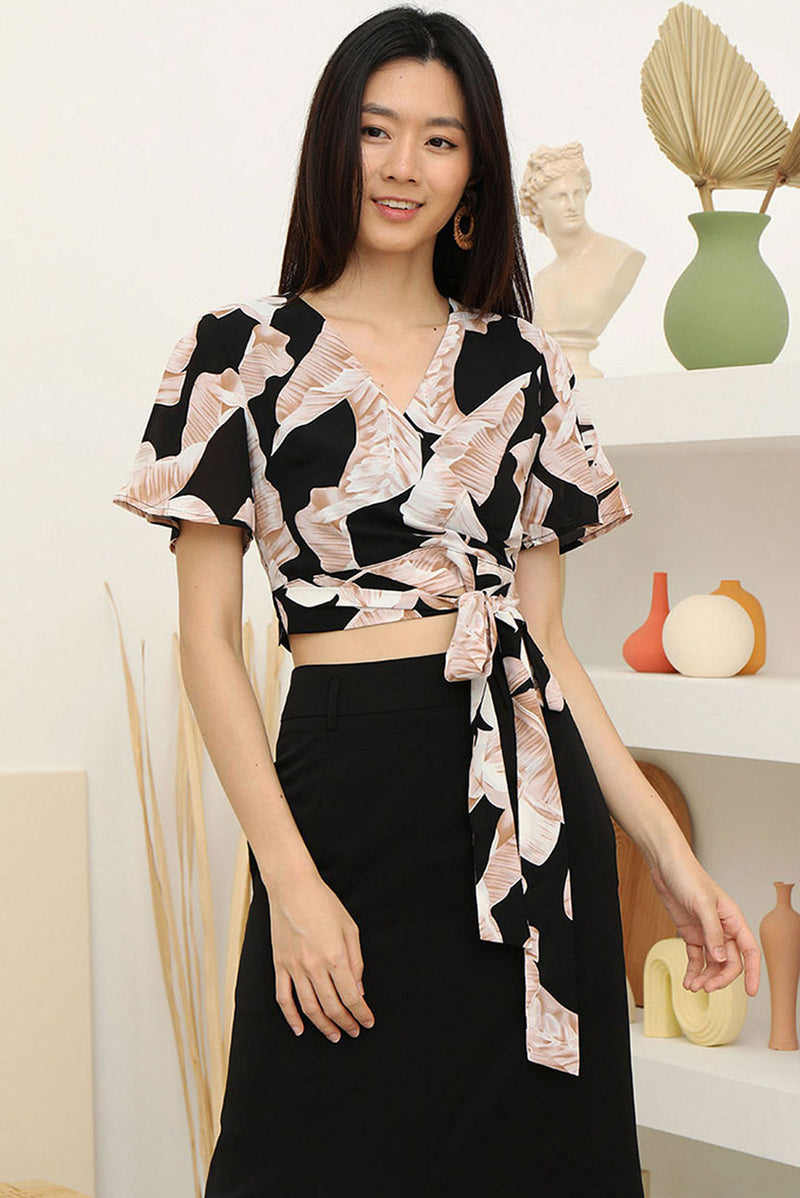 Yuki Kimono Wrap Tie-Waist Top #MadeByDearLyla (Black Foliage) l Dear Lyla Singapore l Shop Women Fashion Yuki is back by popular demand in new lovely prints! Add a hint of kimono vibes to your outfit with Yuki which features an attached sash, overlap neckline and flutter sleeves. Elevate your outfit instantly with this flattering top.