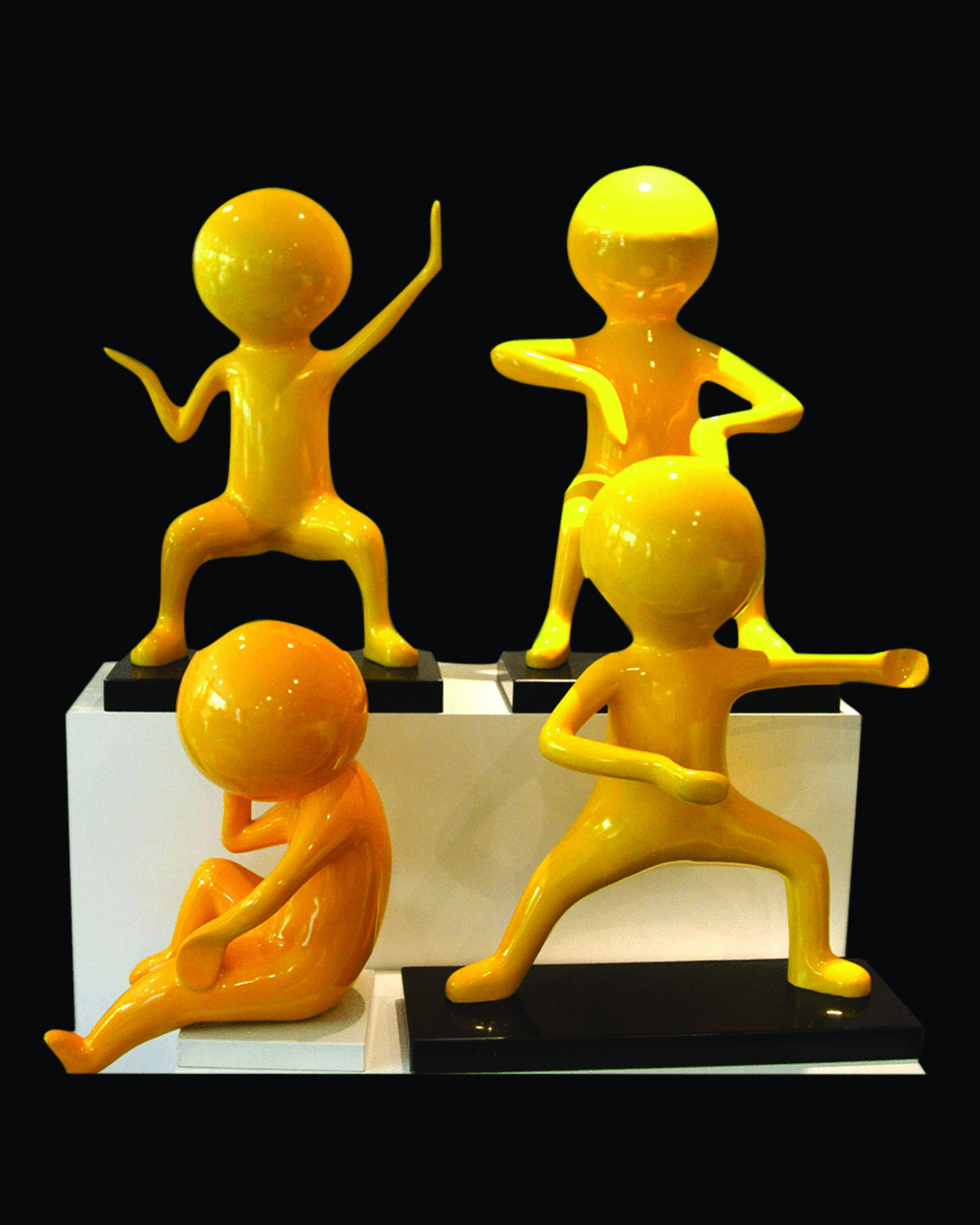 YOKO YELLOW SMALL BOY SCULPTURE  (SET OF 4) ANGIE HOMES