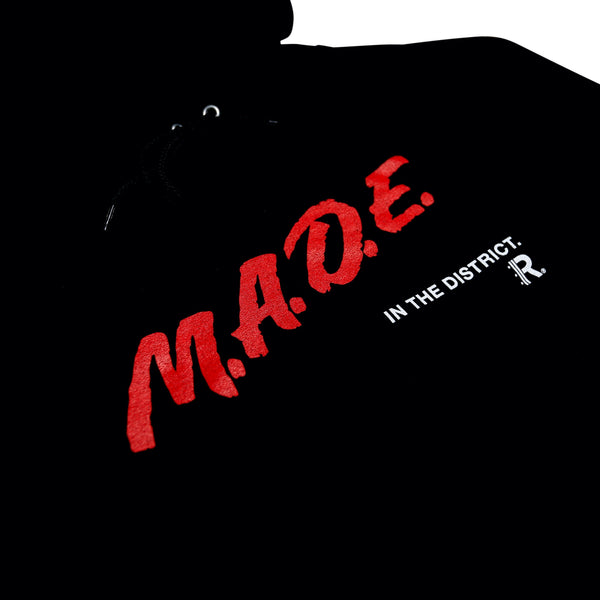 Closeup of M.A.D.E. Champion® Hoodie in Black with Red and White lettering