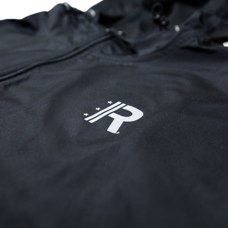 Closeup of R Logo printed in reflective ink on left chest