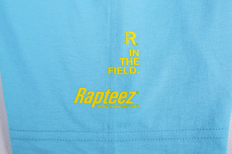 Closeup of yellow screen print on right sleeve of Turquoise Tee