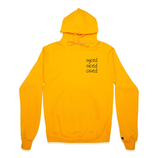 Front of Gold Champion Hoodie with syced siced cised printed on left chest