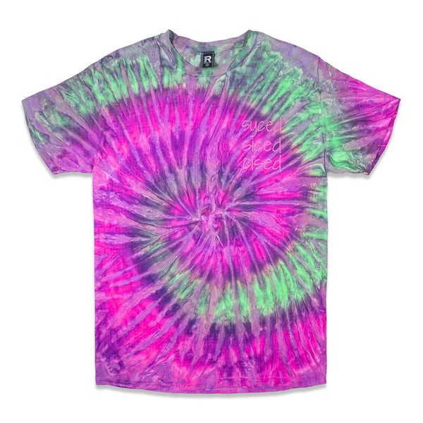 Front of a Purple, Green and Pink Tie Dye Tee with Syced graphic printed in hot pink on left chest.