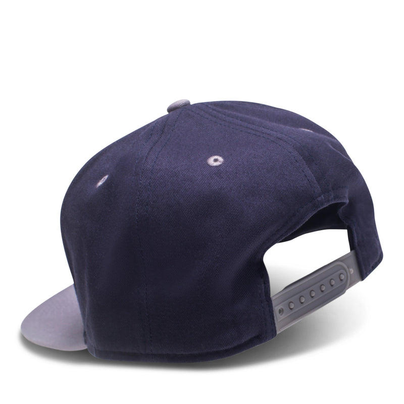 Back of navy 6-panel hat featuring adjustable snapback closure