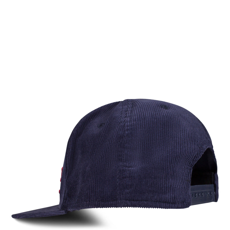Back of 6-panel corduroy hat featuring adjustable snapback closure