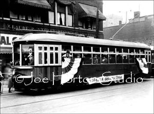 Electric Streetcar In Front Of Claude P. Street
