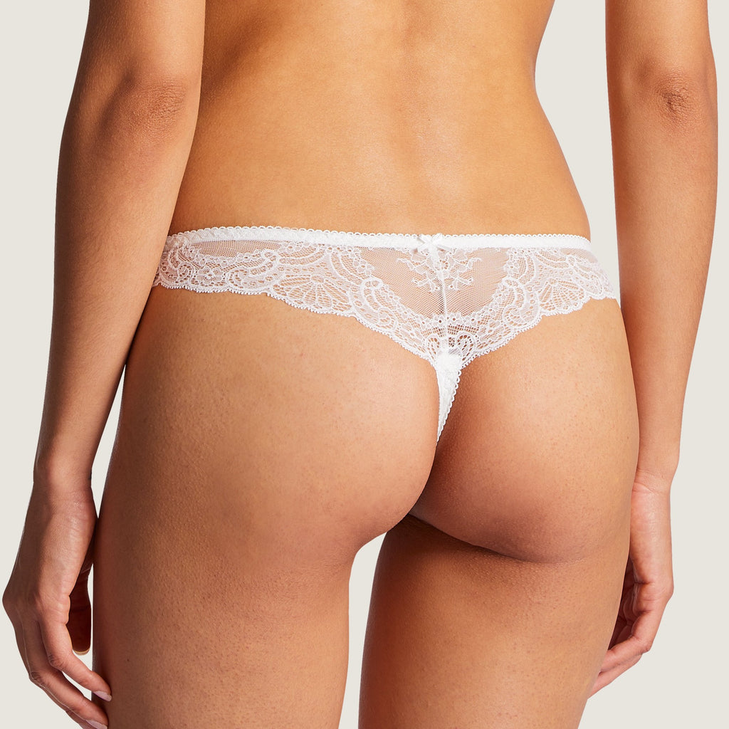 Aubade Danse Thong represents a very fashionable shape with exquisite sophistication. The lace around the hips provides a lightweight feel.Featuring very varied designs, this line offers beautiful yet comfortable lingerie in intense Ivory or Teal.