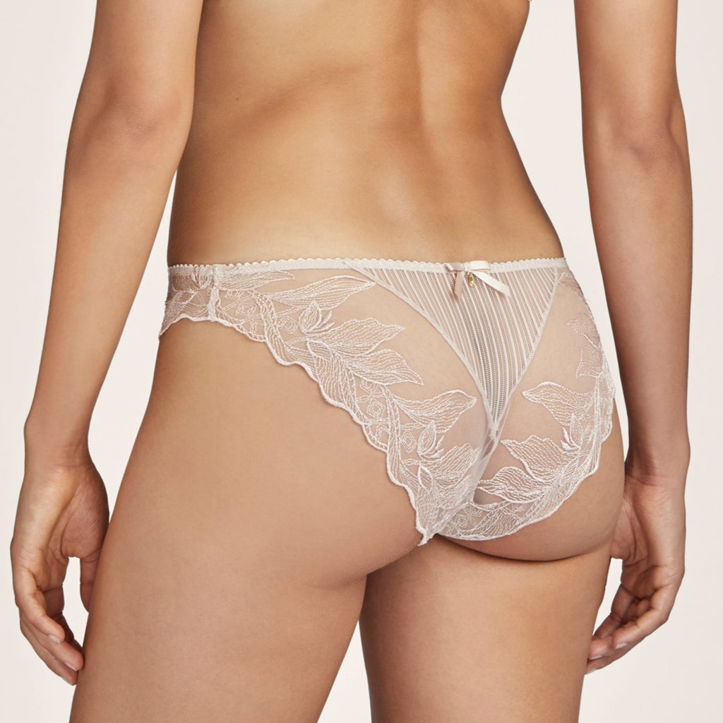 The Aubade Fleur de Tatoo Briefs provide good coverage as well as intricate embroidery. The striped fabric blends wonderfully with the eye-catching floral motif, creating a tattoo effect against the skin. The look is sexy and decidedly modern.  The transparent detail characteristic of the Fleur de Tattoo line sits on an elaborate floral and graphic motif embroidered on a new extra-sheer tulle for a tattoo effect. As though inked onto the skin, the embroidered flowers mingle with the stripes on the fabric.