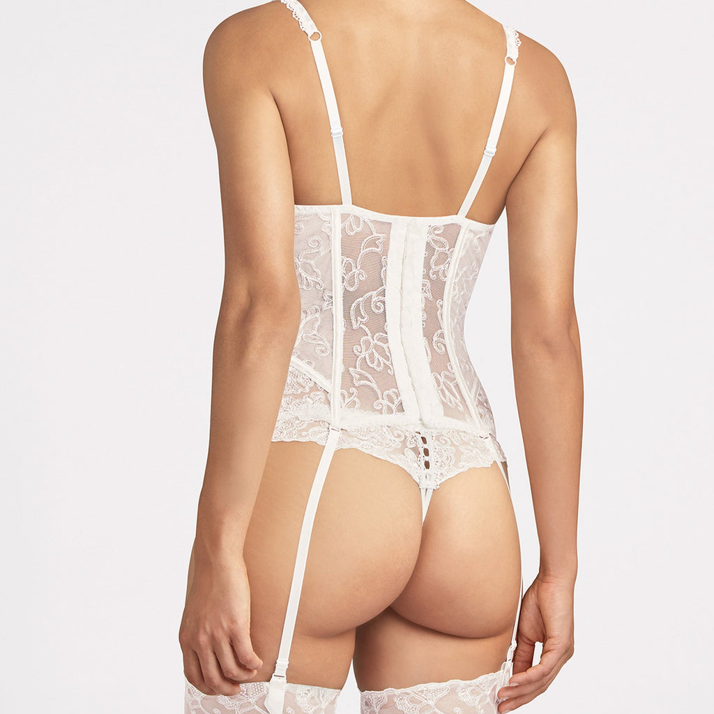 Aubade Pour Toujours Bridal Basque - A truly exceptional piece in the Pour Toujours line, this fully embroidered guepiere enhances the bride's figure with its intricate lace. Bare skin peeps through a fine strip of openwork guipure lace, whilst delicate elasticated picot edging adds a charmingly vintage touch to the piece. The suspender straps are removable.