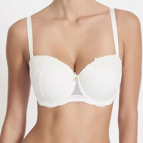The Aubade Comfort Moulded Strapless Bra creates a straight, rounded cleavage, with full support up to an F cup. Thanks to its wide, removable straps, it can be slipped easily under a bustier top. The Belle d'Ispahan line, in pearl tulle with an embroidered motif is enriched by light lace and a delicate jewel