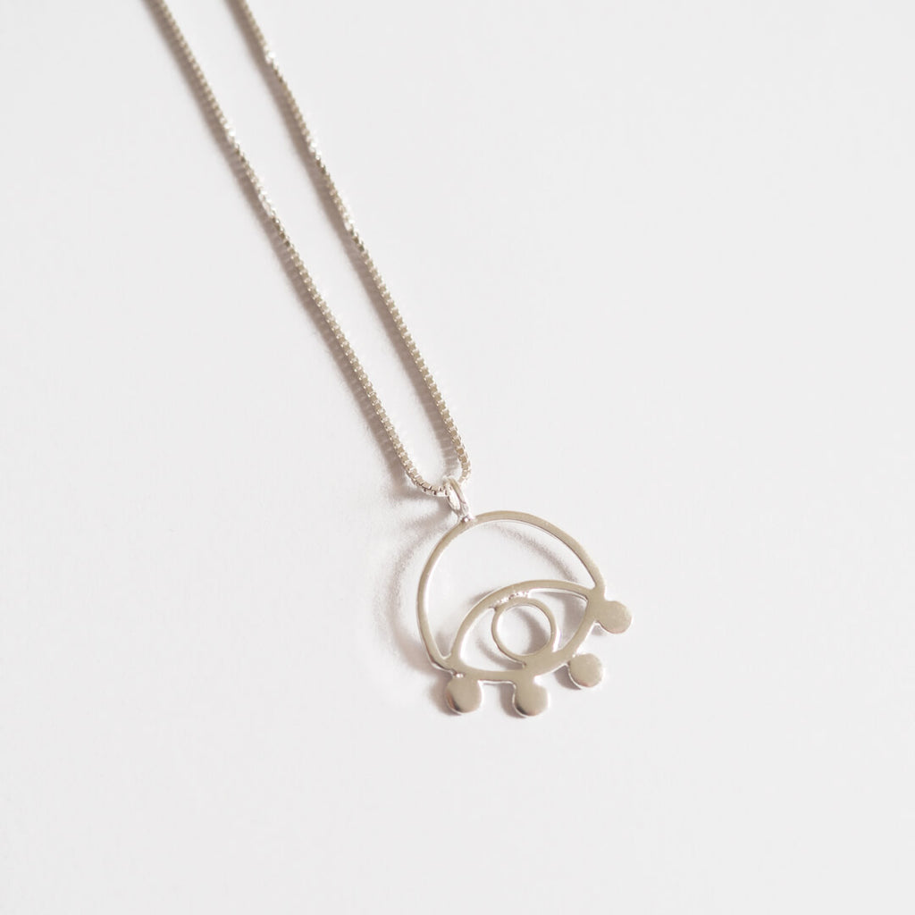 Lima Lima ecosilver eye necklace on a white background.