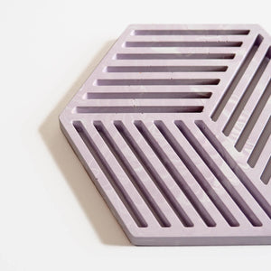 Close up of a hexagonal jesmonite trivet in cool lilac with a subtle marbled finish handmade by Klndra for Curious Makers