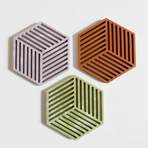 Group of three hexagonal jesmonite coasters or trivets by Klndra for Curious Makers