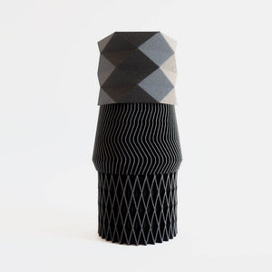 3 black mini 3d printed diamond shaped planters stacked on top of each other.